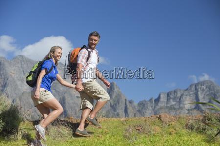 couple hiking on a mountain path