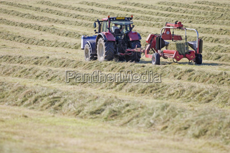 tractor and bale wrapper wrapping bales