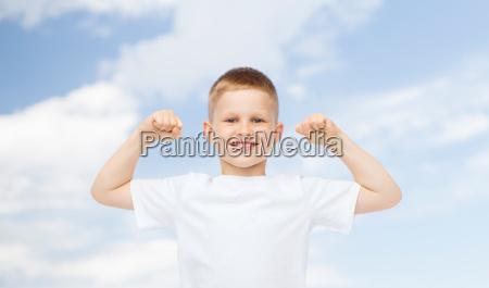 happy little boy in white t