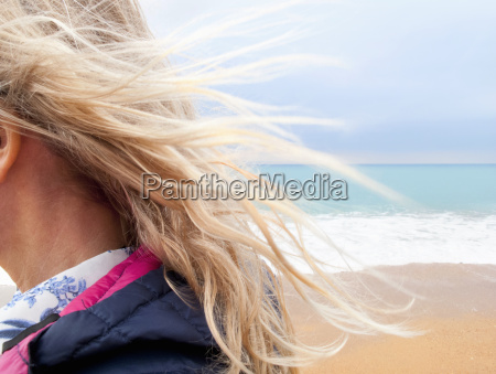 blond hair blowing in breeze on