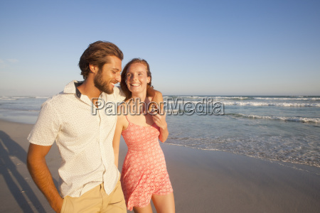 smiling couple man with arm round