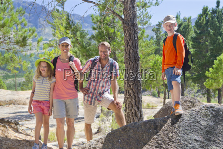portrait of family hiking on mountain