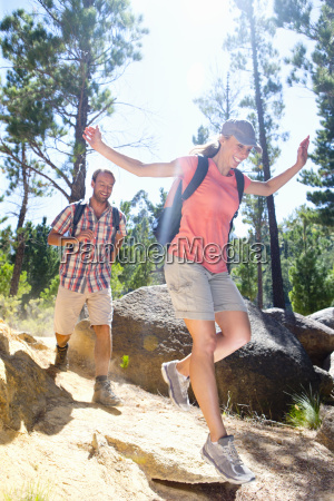 couple hiking on mountain path