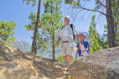senior couple hiking on mountain path