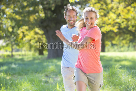 couple playfully chasing each other in