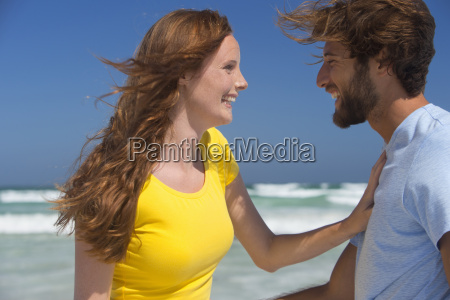portrait of smiling affectionate couple on