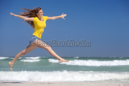 happy woman leaping in air on