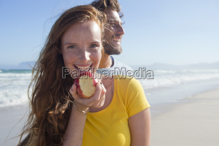 smiling couple on sunny beach with