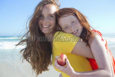 portrait of smiling girl holding apple