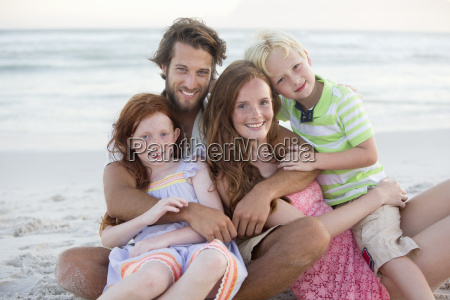 portrait of family smiling at camera