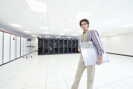 technician looking at camera holding server