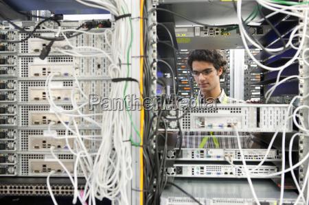 technician working on server in server