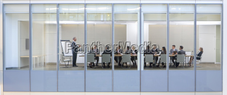 view through window of business meeting