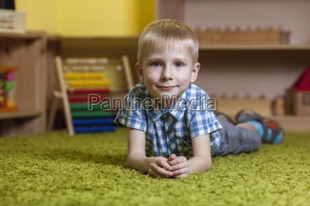 full length portrait of boy lying