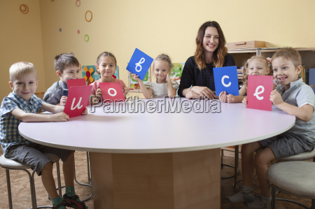 portrait of happy teacher with children