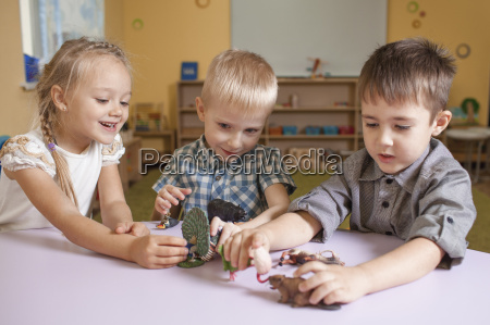 children playing with animal toys at
