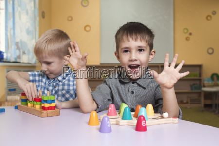 cute little boys playing with toys