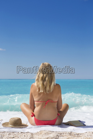 woman looking out to sea sitting