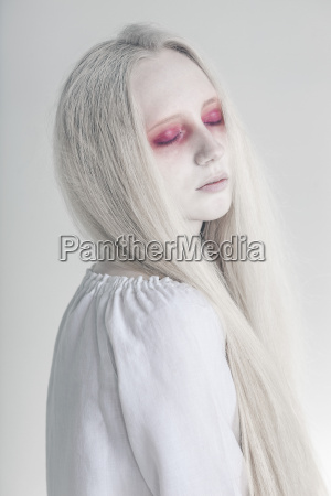 spooky woman with closed red eyes