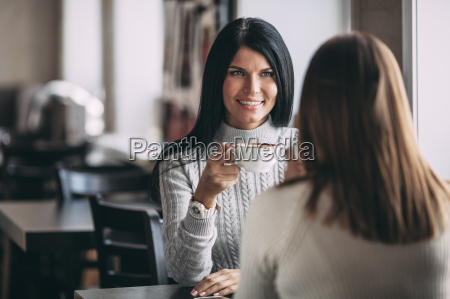 happy young woman having coffee with