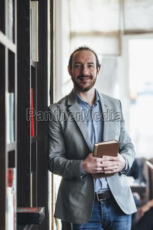 portrait of happy mid adult businessman
