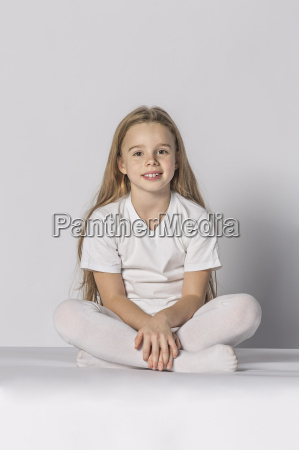 full length portrait of smiling girl