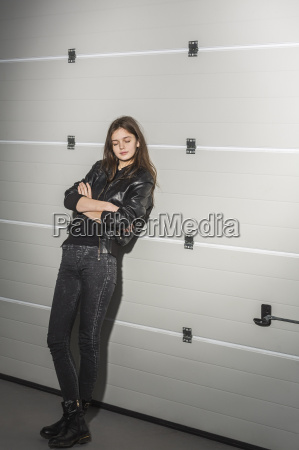 relaxed young woman with arms crossed