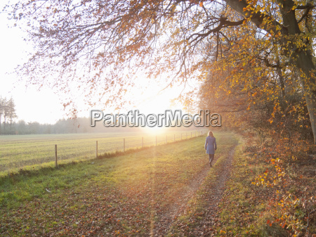 woman walking in countryside in the