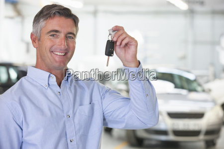 man holding car keys of new