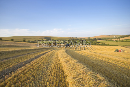 combine harvester straw baler and tractor