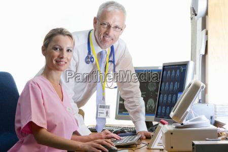 portrait confident doctor and nurse reviewing