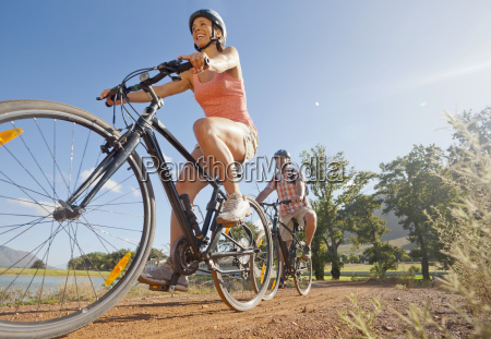 couple mountain biking in countryside