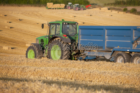 tractor and trailers with bales of