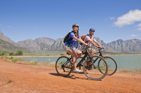couple mountain biking in mountains by