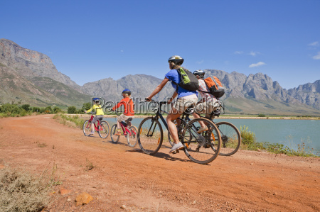 family mountain biking in mountains by