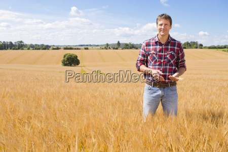 portrait confident farmer in sunny rural