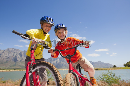 portrait of children on mountain bikes