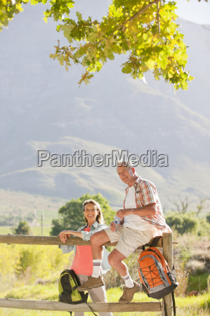 senior couple out for walk resting