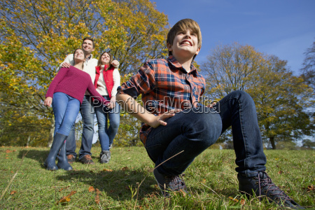 happy family with boy kneeling in
