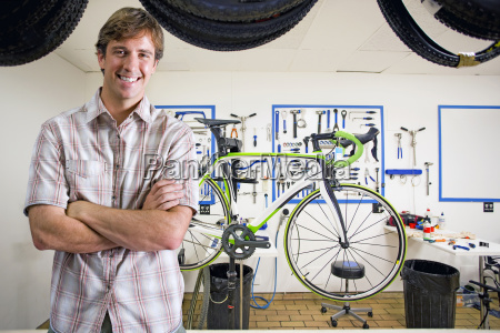 store owner or customer in bicycle