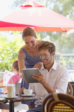 couple looking at digital tablet in
