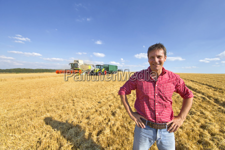 portrait confident farmer in sunny barley