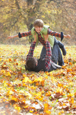 father holding son up like a