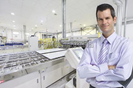 portrait of businessman owner smiling at
