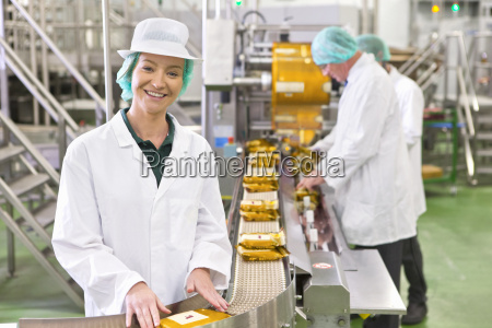 portrait smiling worker at production line