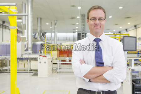 portrait of businessman smiling at camera