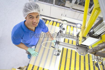 factory floor worker smiling at camera