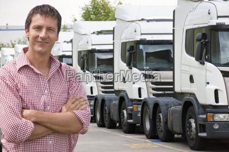 portrait of confident freight transportation truck
