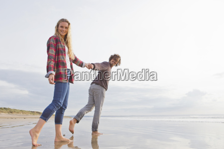 portrait smiling couple walking and holding