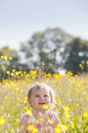 portrait of smiling baby sitting in